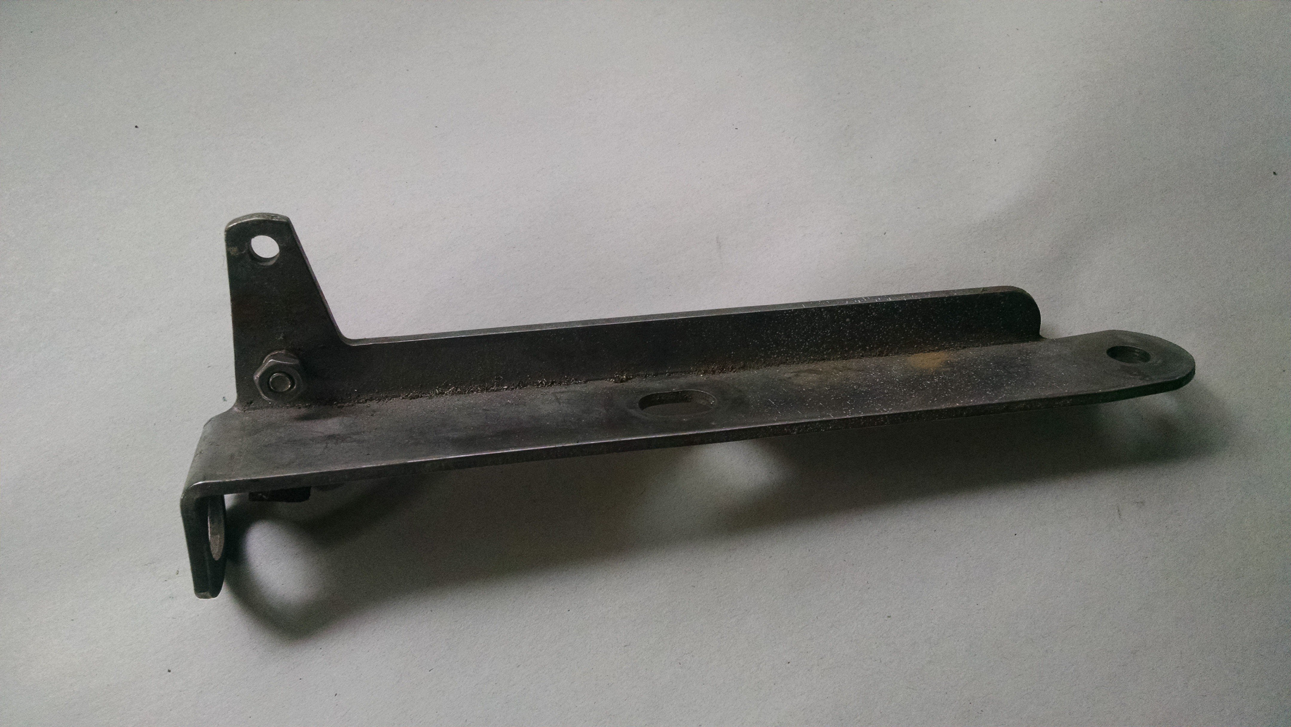 Steering Extension Shift Cable Bracket — USED